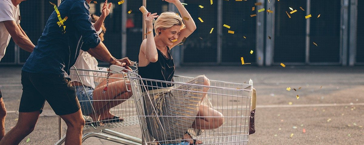 people riding shopping carts