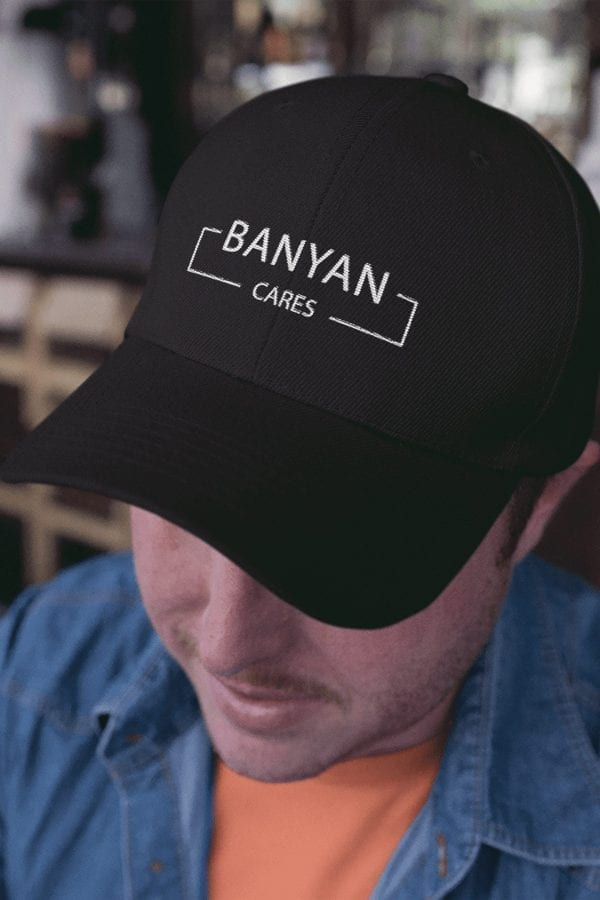 Closeup Guy Wearing Banyan Cares Block Baseball Hat Black