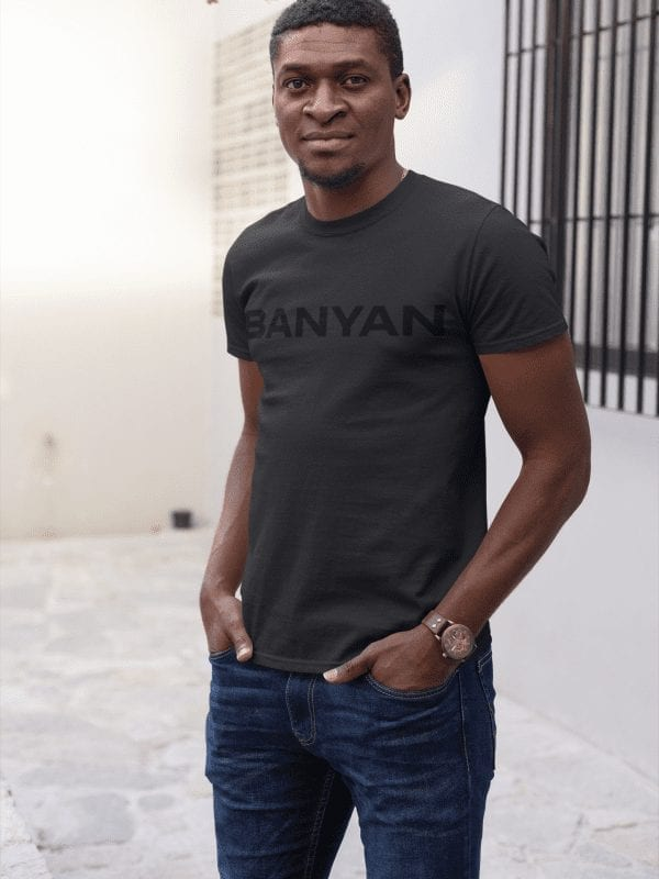 Man Standing Casually Wearing Banyan Black on Black T-Shirt