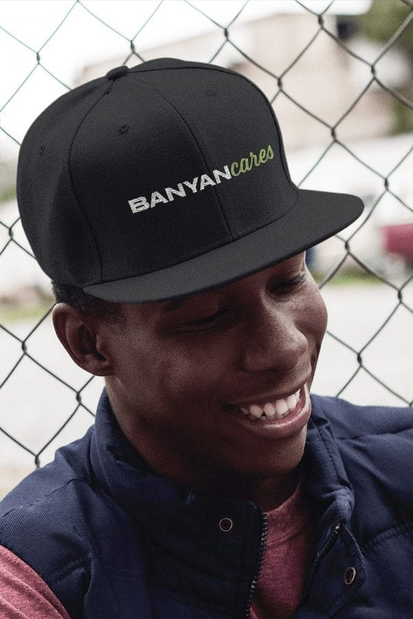 Smiling Man Banyan Cares Script Baseball Hat
