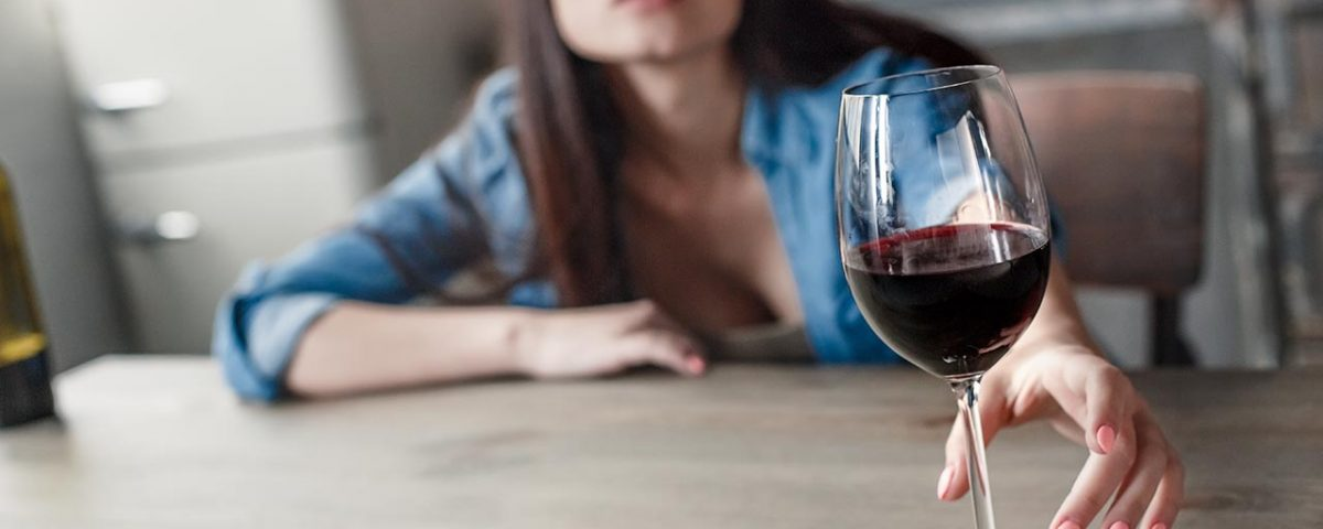 woman with glass of wine